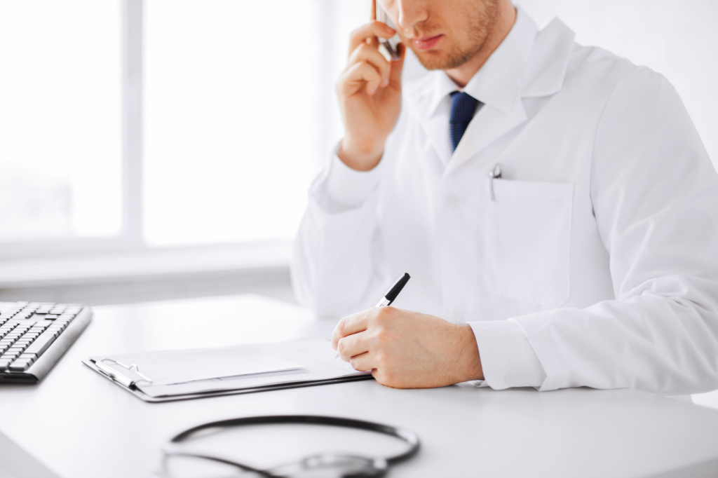 doctor-paperwork-on-phone.jpg
